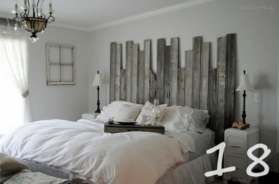 fence being put to good use as a headboard in this cottage bedroom